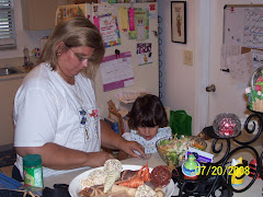 Samantha helping Grammy (me) make a salad