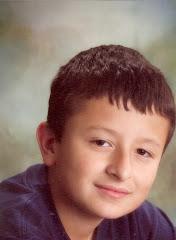 """""""Mi sobrino Kevin Grisales Galeano"""". La picardia de su expresión es para asustarse."""
