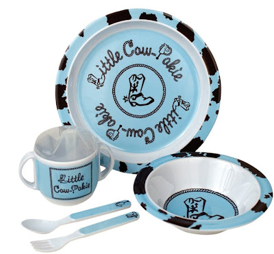 Lil cow pokie melamine set includes a sippy cup. See Manual Woodworkers and Weavers Izzy collection of children's gifts at the 2009 Atlanta gift show and other gift markets