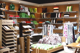 Relish, a Portland Oregon home furnishings store is housed in a former garage. Here is a Chilewich display. christinesisson.wordpress.com.
