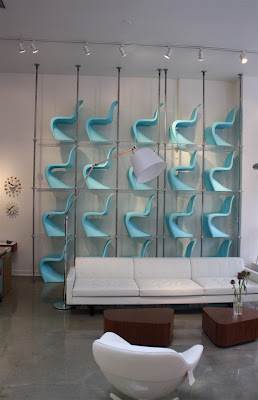 A wall of Verner Panton chairs in Hive Modern, Portland, OR, impresses style and trends writer and public relations consultant Christine Sisson