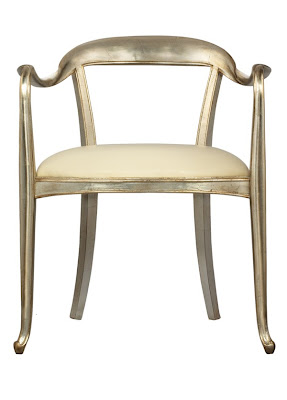 The 7803 chair from Samuelson Furniture has an Art Nouveau design. The company sells to interior designers. Side chair with arms, silver finish, leather seat, hardwood frame