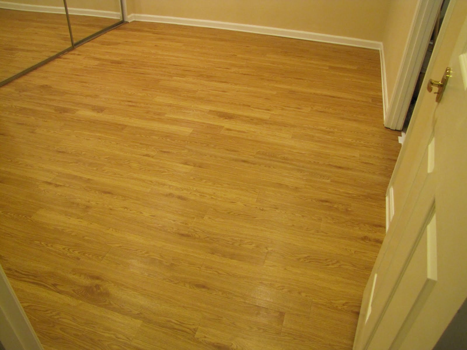 Bibbidi bobbidi beautiful our faux wood floor for Fake wood flooring