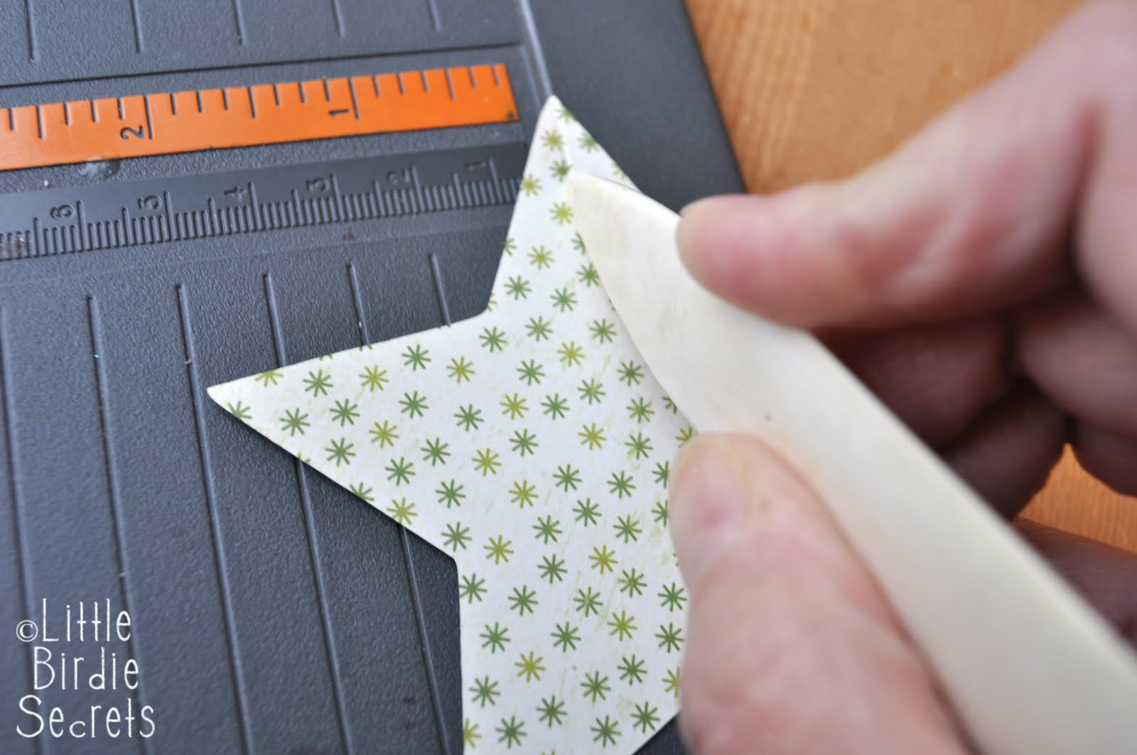 How to make a 3d star christmas decoration - Score A Line From The Top Of Each Point Straight Down To The Inside Point Do This For Each Of The Five Points