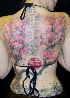 Lower back Cherry Tribal tattoo paint