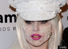 Lady Gaga glues pearls to her face and body.