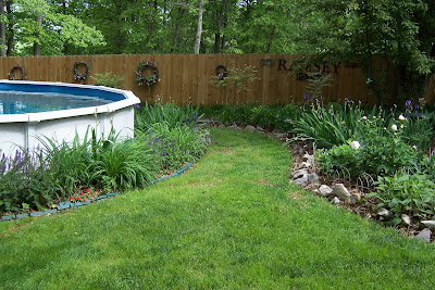 in the garden: landscaping your above ground pool
