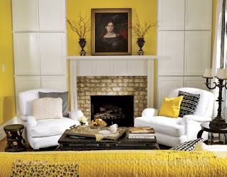 Yellow paint walls with white trim fireplace @ Chasing Davies