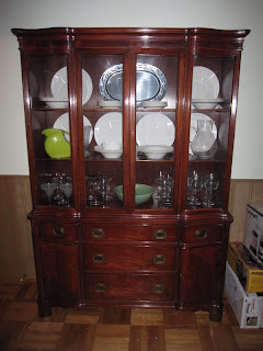 China Cabinet Organized with White Dishes