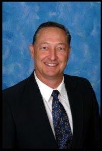 Commissioner John Sims