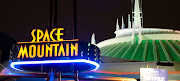 . within the Magic Kingdom theme park. Featuring lots of flashing lights, . (spacemt )