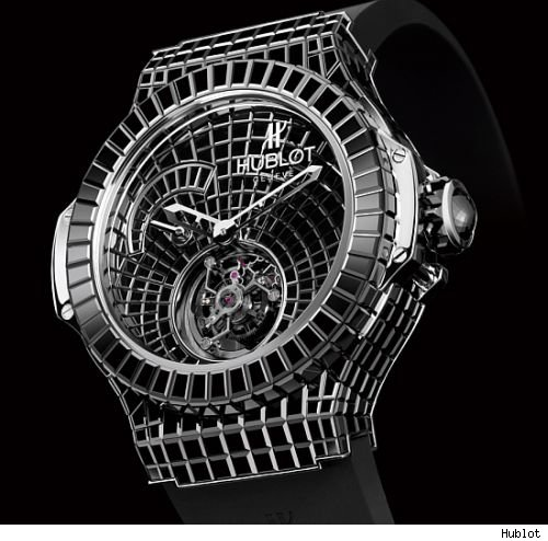 Hublot made the million dollar big bang watch out of white gold and rare baguette cut black diamonds. almost 550 diamonds are all over the watch,
