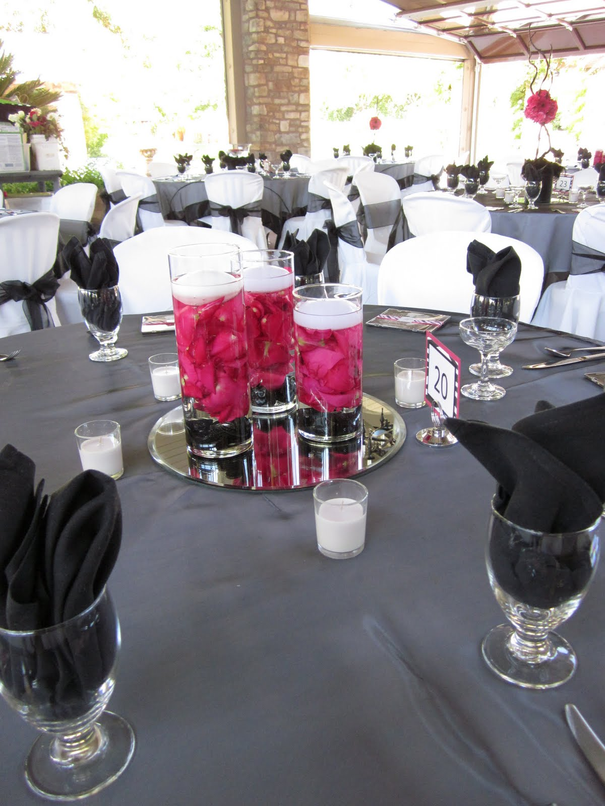Brown bunny flowers july 17 2010 ashley and ryans wedding the other two centerpieces used our glass vases and bowls with submerged hot pink rose petals and floating candles reviewsmspy