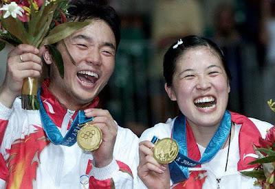 Sydney 2000 - Zhang Jun y Gao Ling, campeon@s en dobles mixtos de badminto