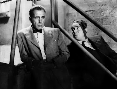 Humphrey Bogart y Roy Silvers en Deadline USA (1952)