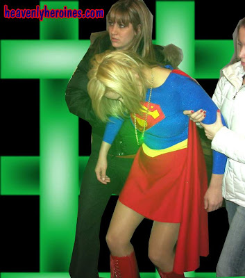 kryptonite induced weakness. Super Heather is held helpless.