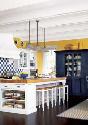 colors coupled with yellow this kitchen is happy crisp and bold
