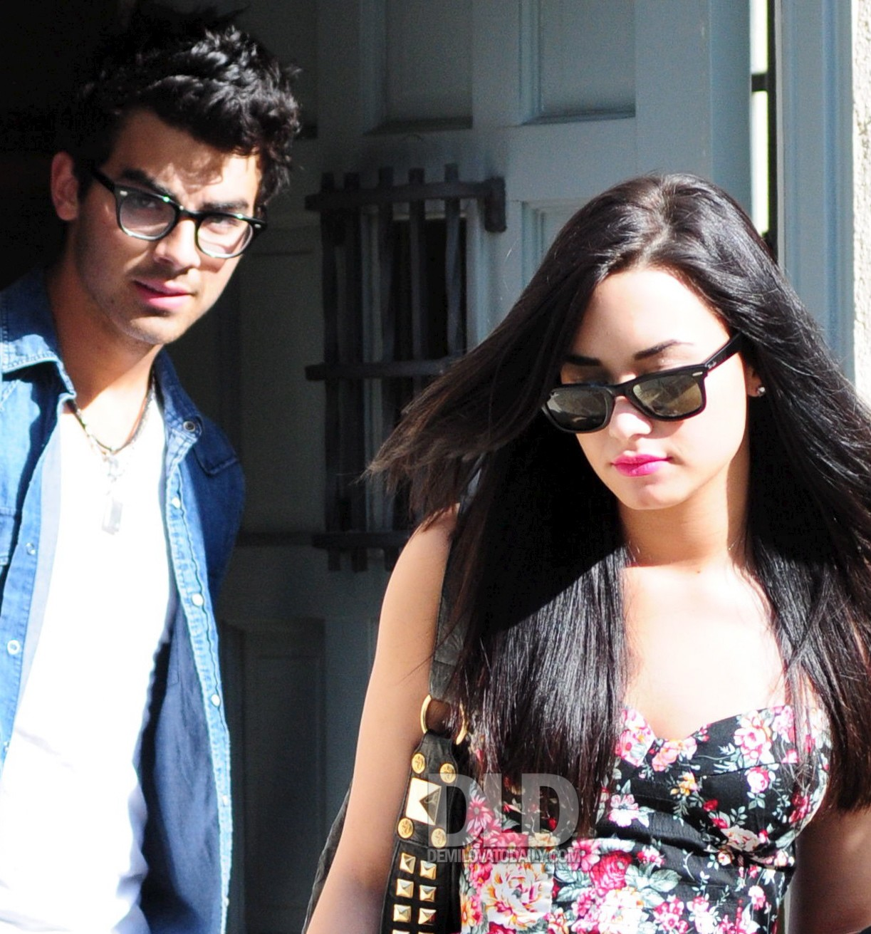 Demi Lovato and Joe Jonas cuddle up to Mickey Mouse as they run around Walt