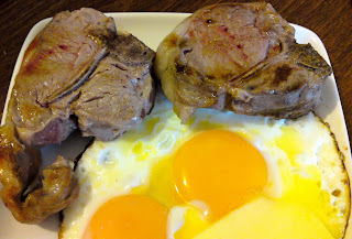 Lamb chops and fried eggs with butter