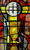stained glass style picture of the communion cup and bread