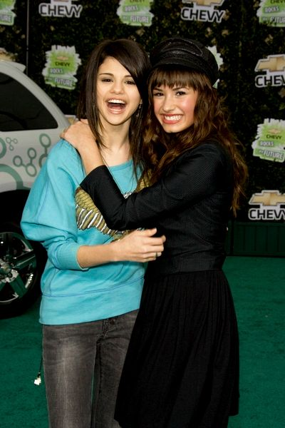 selena gomez and demi lovato and taylor swift. lovato and taylor swift.