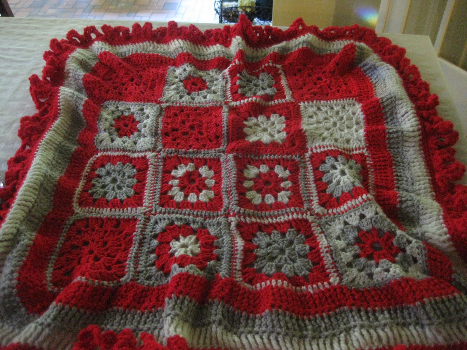 crocheted monkey blanket with only the monkey faces missing. Crocheted ...