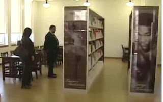 man and woman looking at books in Houston's Gregory Library