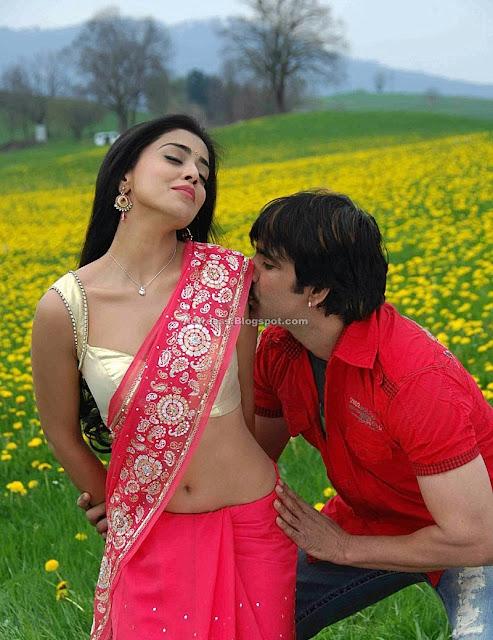 Shriya Saran Hot Navel Show In Yellow Saree