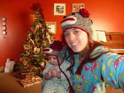 baby and mother each wearing a crochet sock monkey hat