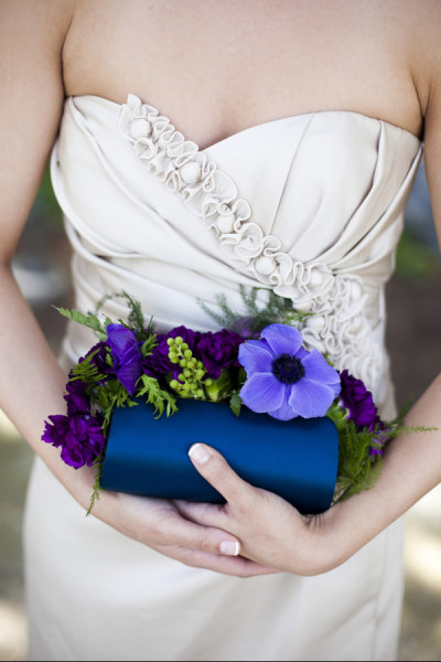 A bridesmaid holding a very unique clutch bouquet!