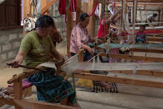weavers at Lao Sericulture Company's organic farm