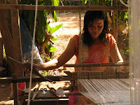 Thai weaver working at her floor loom
