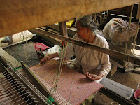 weaving khit at a floor loom in Thailand