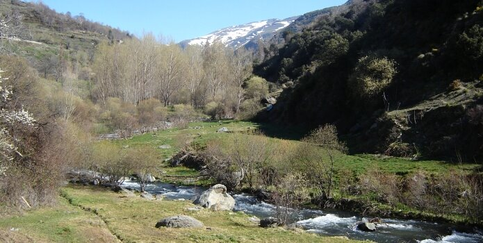 Río Trevélez valley as seen from the bridge on the first spring day of 2009 - foto: casa rural El Paraje