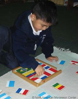 NAMC montessori education reform public schooling obama child with flag puzzle