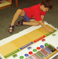 NAMC montessori math materials curriculum explained all ages boy using pegboard