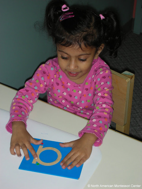 NAMC montessori education from concrete to abstract girl sandpaper letters