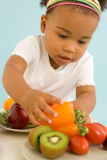 NAMC Montessori school nutrition and health tips child with vegetables