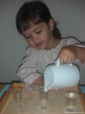 NAMC Montessori preschool practical life activities pouring water girl using pitcher