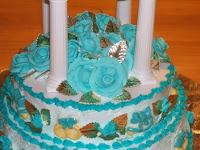 50th anniversary cake with teal blue roses and gold leaf