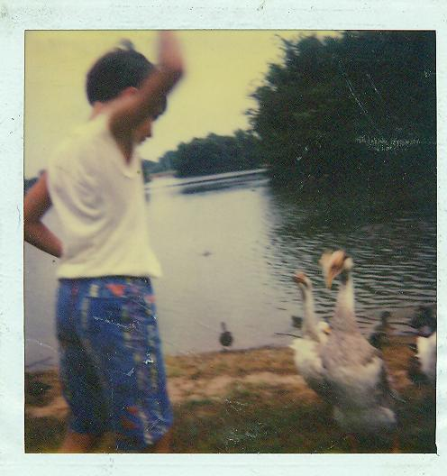 Joe feeds hungry duck-Hendersonville Lake-DAD loves it!
