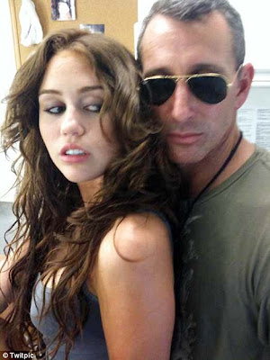 Miley Cyrus strikes a provocative pose with Adam Shankman