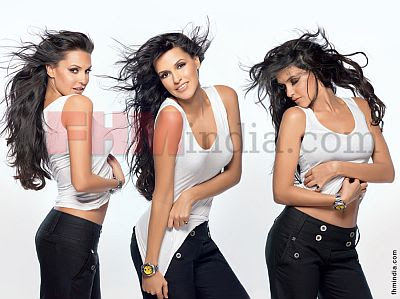 Neha Dhupia Hot Photoshoot for FHM Magazine July 2009