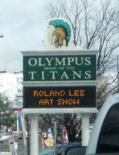 Marquee sign in front of Olympus High School advertised the Roland Lee Art Show