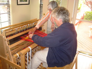 Nellie Lee and Aleen McGuire weaving