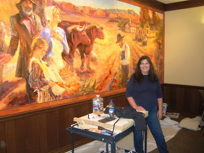 Artist Julie Rogers with her mural at the Santa Clara City Offices
