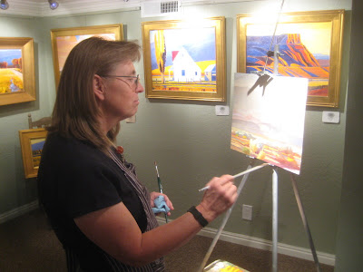 Artist Dilleen Marsh paints on location during the Art Walk in downtown St. George