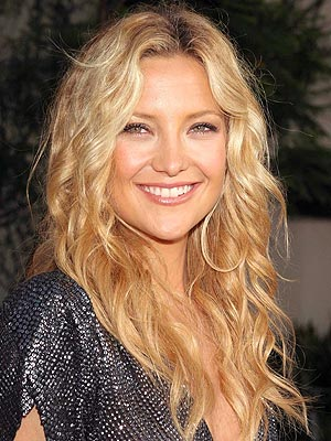 Hairstyle: Shoulder length hairstyle with large soft waves.