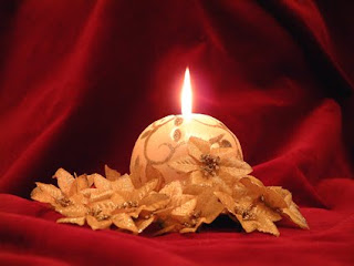 Christmas Candle on Red Background