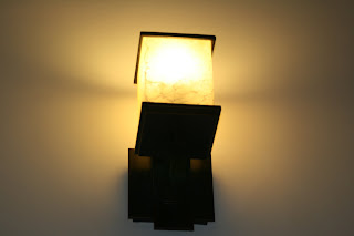 downsizing in the size of the fixture and the number of bulbs although